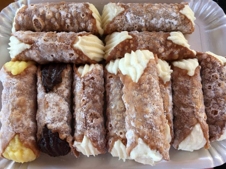 Cannoli filled with cream, ricotta cheese or chocolate