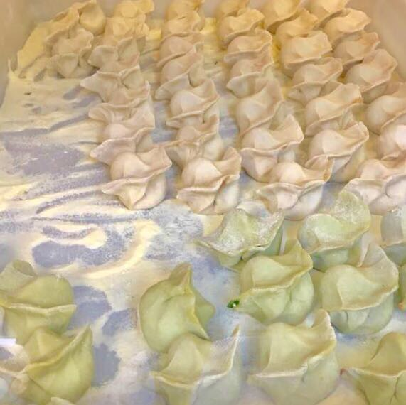 Fresh dumplings ready to be cooked