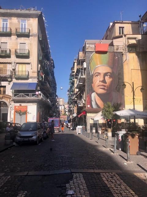 Via Duomo with Jorit's mural of San Gennaro